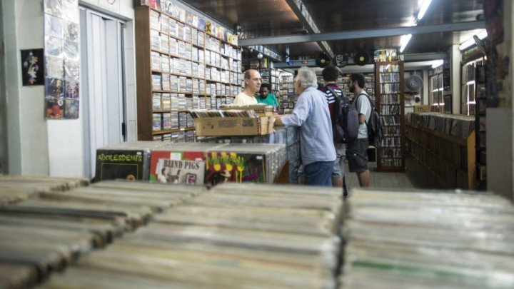 Friends at the record store, Baratos Afins.São Paulo, Brazil
