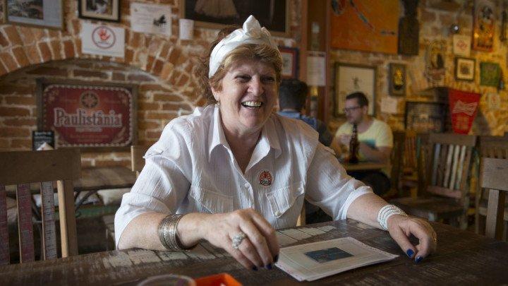 Portrait of Dona Luisa by Natalia Pereira, in Rota do Acarajé - a brazillian restaurant in São Paulo, Brazil.